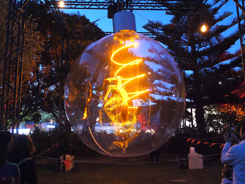 Giant Lightbulb with aerialist inside